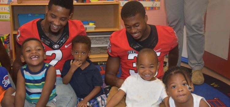 UGA Football Players Partner for Vision Screenings